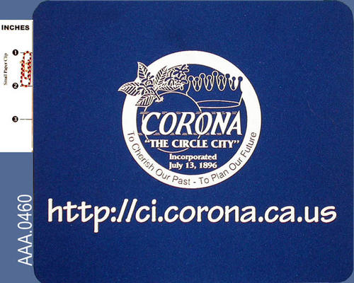 "This artifact is a blue mousepad with white leters.  There is a Corona City logo in the center and below the logo is the URL:  ""http://ci.corona.ca.us."""