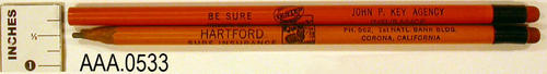 "This artifact collection consists of two pencils:  1 orange, 1 off yellow.  The text on the pencils read:  ""Be sure to insure with HARTFORD insurance.  John P. Key Agency - Insurance - PH 562, 1st National Bank Blvd. - Corona, California.""  CONDITION:  1 used, 1 unused."