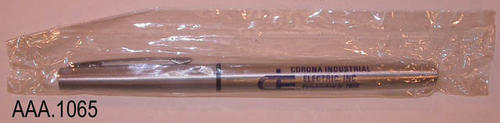 "This artifact is a pen, in the original packaging, from Corona Industrial Electric.  The pen is silver with dark blue text which reads:  ""Corona Industrial Electric, Inc. - Established in 1958 - 25 Years of Service - 24 Hr. Phones. (714) 737-4570 / 689-1724.""  CONDITION:  This artifact is in excellent condition."