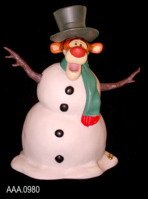 "This artifact is a ""Chilly willy silly ol' Tigger"" from the Cast Art, Pooh and Friends  - #1215498 - line and was made in Thailand.  It measures 5"" x 2 3/4"".  There is a Tigger head on a snowman body.  There are sticks for arms and green scarf around the neck. A black top hat is on Tigger's head.  CONDITION:  This artifact is in excellent condition. Tigger is a Disney character."