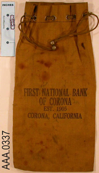 "This artifact is a light brown money bag with the following text imprinted on the bag:  ""First National Bank of Corona - Est. 1905 - Corona, California.""  CONDITION:  This artifact is soiled."