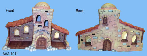 "This artifact is the ""Bethlehem Inn"" -  DX474. The Bethlehem Inn is part of the Nativity Collection belonging to the Dreamsicles line made in China .  It has a white power cord and when plugged in, the tower lights up.  It measures 14"" x 4 1/2"" x 9""."