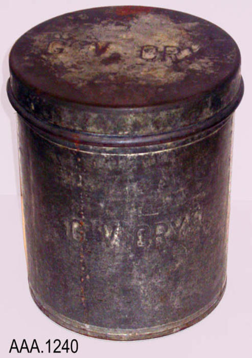"Thisartifact is a round, steel, can with a lid.  Raised lettering on the lid reads:  ""G  V  CRY.""  This same text is on the can in raised letters.  Raised lettering on one part of the can reads, ""10 QTS.  LIQUID.""  This can measures 9"" (D),  11"" (H)."