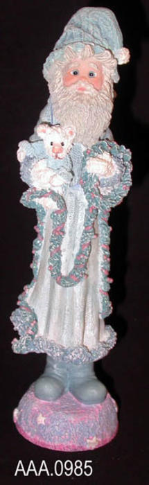 "This artifact is a piece of cast art entitled, ""Bearing Gifts."" It depicts a man standing holding a lamb.  This figurine is from the Dreamsicles Northern Lights line - #60257 - and was made in China.  It measures 7"" x 1 3/4""."