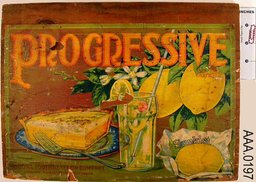 "This artifact is a Corona Foothill Lemon Co., ""PROGRESSIVE,"" citrus fruit label mounted on wood and is used on the side of packing crates.  The word PROGRESSIVE is printed in yellow with the text bordered in orange at the top of the label.  A slice of lemon pie is on the left, a glass of lemonade in the center,  two lemons on a leafy branch in the upper right corner, and a lemon on a paper Sunkist wrapper is in the lower right corner.  CONDITION:  This label is extremely faded with numerous cracks."