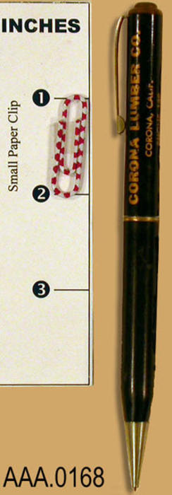 "This artifact is a mechanical pencil.  It is black  and is imprinted with gold colored text reading:  ""Corona Lumber Co.,  Corona, California.  Phone 139."""