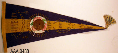 "This artifact is a 22 1/4"" x 9 1/4"" blue and yellow pennant.  Souvenir 1911 - Round States - ""Merced Merchants Cardinal and Produce Exposition - May 16-20, 1911."""