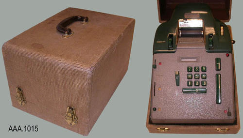 This artifact is an electric Victor adding machine.  The plastic case covering the working parts of the machine is dark green and silver.  One lever is missing.  The carrying case is a brown check design with a handle.  Two snap locks secure the hinged top to the base.  CONDITION: The case is in good condition but does show minor wear on the top edge of the case.