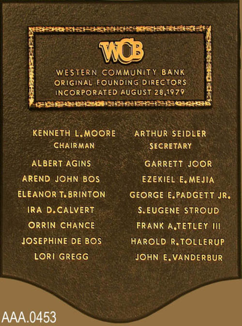 This artifact is the wall plaque for the Western Community Bank giving the incorporation date of 8-28-1979, and the names of the sixteen original founding directors. Donor's Remarks:  The bank was bought out in 1994.