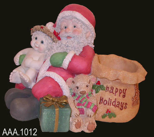 "This artifact is part of the Dreamsicles collection.  This figurine is entitled, ""Happy Holidays,""  #11819 - and depicts Santa and bag sitting with a cherub on his knee. A gift and teddy bear sit on the ground next to him.  This artifact measures 9 1/2"" x 6 1/2"" x 8 1/2"".  CONDITION:  The artifact and original container are in excellent condition."