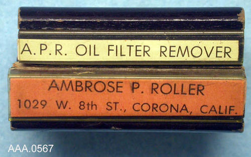 "This artifact is a rubber stamp.  The stamped impression reads:  ""A.P.R. Oil Filter Remover - Ambrose P. Roller - 1029 8th Str., Corona, Calif."" Donor's Remarks:  This artifact was owned by Jenny Adamo. It belonged to the Rutledge Family."