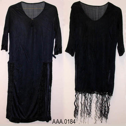 This artifact consists of one women's dress and dress top circa 1920's.