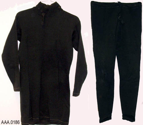 This artifact is a three piece, black wool, man's bathing costume or possibly a boxing uniform [the library staff cannot document which it is].  It has one top and two bottoms, one with feet.  CONDITION:  This artifact is mildewed, stained and has insect damage.