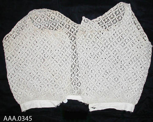 This artifact is a cotton, lace vest.