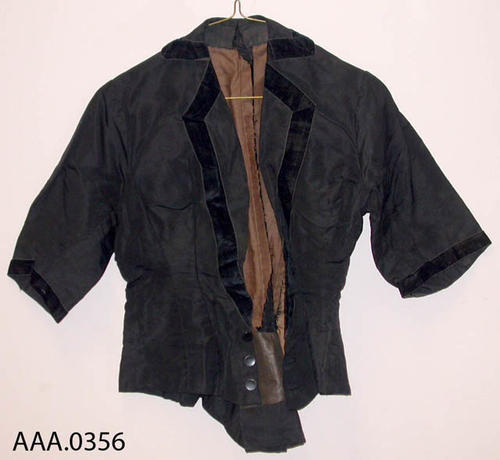 This artifact is a black women's jacket.  It belonged to Frances Clark.