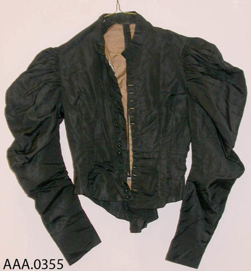 This artifact is a black jacket.  It belonged to Frances Clark.