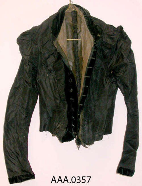 This artifact is a black jacket, circa 1910, and belonged to Frances Clark.