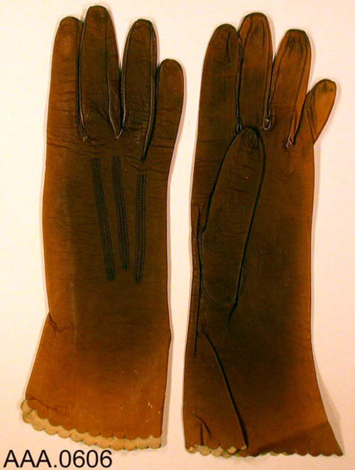 "This artifact is one pair of light brown, ""Lady Gay by Osborn"" gloves, women's size 7 1/4.  These gloves are made of real kid.  CONDITION:  These gloves are well worn, but in good condition."