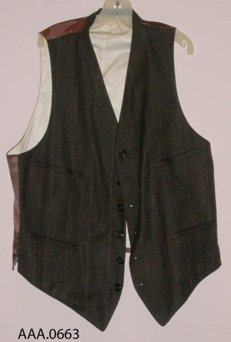 This artifact is a small, dark brown vest with dark red and gray pinstripes.  Would fit a small man or child.  CONDITION:  Good