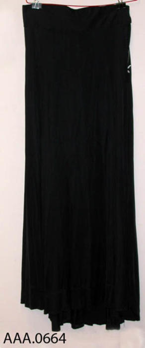 This artifact is a black jersey, ladies skirt. Circa 1870's-1910.