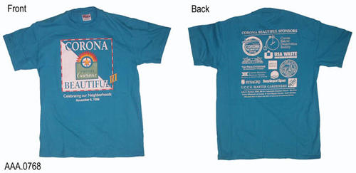 "This artifact collection consists of two, blue tee shirts (size M).  The front has the Corona Beautiful Logos with ""Celebrating Our Neighborhood - November 6, 1999.""  On the back are listed the Corona Beautiful Sponsors."