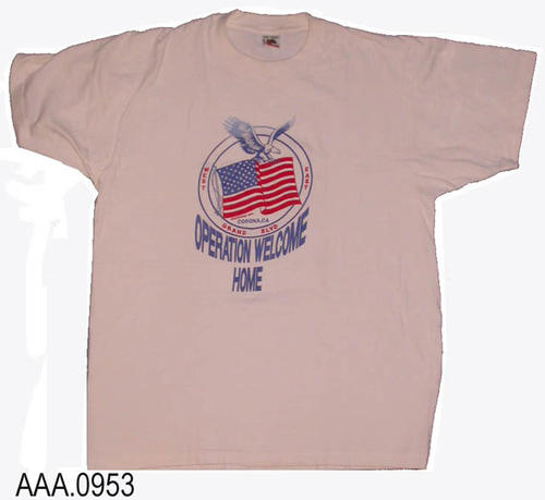 This artifact is a sample T-shirt distributed as part of the Corona Chamber of Commerce Operation Welcome Home Support Rally for troops in the Persian Gulf War on Saturday, March 16, 1991.  This event took place on Grand Blvd.