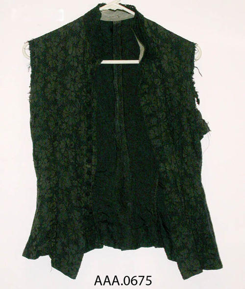 This artifact is a sleeveless, blace lace, blouse.  Circa 1870's-1910. CONDITION:  Sleeves are missing, fair general condition.  This blouse goes with artifact AAA.0674.