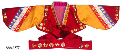 "This artifact is a jacket that is part of a Korean costume.  The jacket is multi-colored having red, gold, orange, white, and blue material.  There is a metalic gold, flower design featured on the jacket. On the front of the jacket are red ties measuring 23 1/4"" that also have a metalic gold geometric design at the end.    From sleeve-end to sleeve-end is 28"" and the jacket is 8 1/2"" in width.  CONDITION:  One tie has become detached from the jacket."