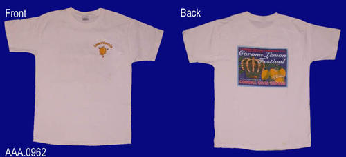 "This artifact is a white T shirt (Adult L).  On the front in the pocket area is the word ""Lemonhead,"" over a cartoon lemon.  On the back is a logo in the form of a historic citrus label for the Corona Lemon Festival."