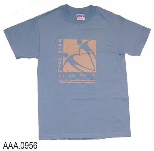 "This artifact is a light blue T shirt (Adult S) with the following text on the front:  ""Teen Talk 2001 - Co-Sponsored By Alternative To Domestic Violance, Unity, and Corona-Norco Unified School Distict.  A logo also appears on the front of the T Shirt."