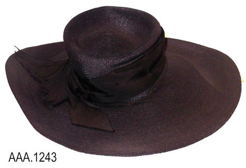 "This artifact is a black, straw,  woman's hat from the turn of the century (1890-1910).  It is trimmed with black grosgrain ribbon.  The brim diameter is 16 1/4""."