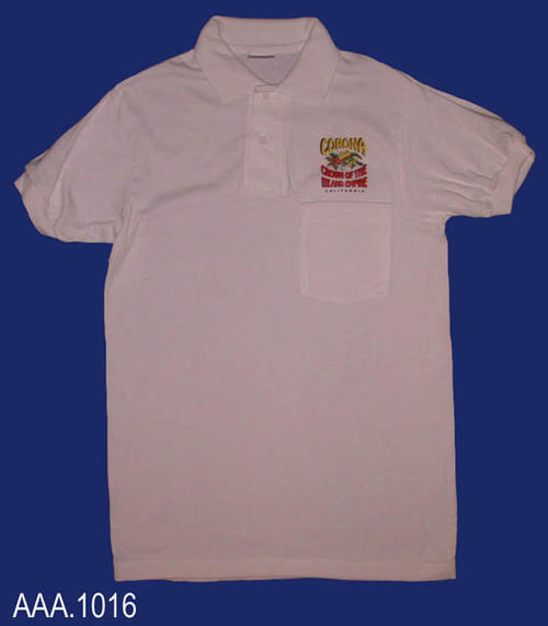 "This artifact collection consist of three, small, white polo shirts.  Above the pocket is the text:  ""Corona - a graphic consisting of a crown and a union of lemons and oranges - Crown of the Inland Empire - California.""  CONDITION:  This artifact is in excellent condition."