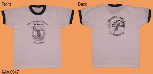 "This artifact is a white T shirt with dark blue trim around the sleeves and neck.  On the front in black print is the following text:  ""Fleet Analysis Center - 5K Race.""  Below this text is the FLTAC Logo.  Under the logo the text reads:  ""June 1985.""  On the back in black print is the text:  ""Sherman Indian - under this text a logo - below the logo the text 19  Braves  85"""