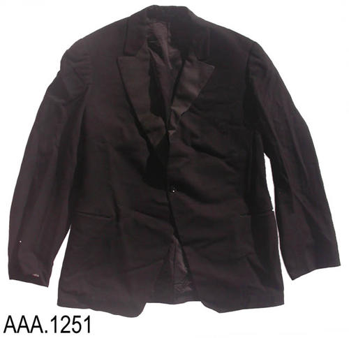"This article is a black, one button, tuxedo coat.  Inside the coat the initials ""CJT"" are embroidered in script letters.  Adult size.  CONDITION:  There is moth damage on the right sleeve where the sleeve joins the coat.  There is also moth damage on the coat near the right lapel."