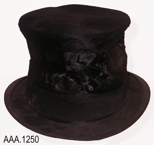 This artifact is an adult size, black top hat.  C. 1909