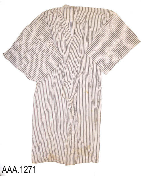 This artifact is an adult sized robe with mid-length sleeves.  The robe is white with narrow, vertical, charcoal stripes.  CONDITION:  There are rips in the seams under both arms.  Some brown staining can be observed at various places on the garmet.