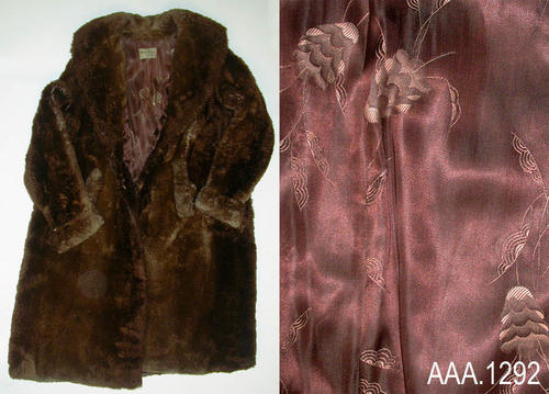 "This artifact is a heavy, long, woman's beaver coat with silk lining.  It measures 19 1/2"" from shoulder seam to shoulder seam and 49 1/2"" in length from the collar to the hem of the coat.  CONDITION:  A small separation was observed on the right shoulder seam."