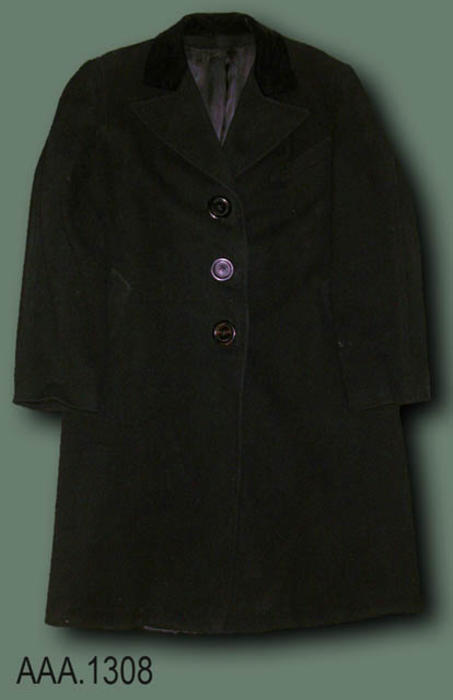 "This artifact is a black overcoat.  It has a partial velvet collar and is silked lined.  This coat measures 44 1/2"" in length and 17 1/2"" from shoulder seam to shoulder seam.  Label one reads: ""Westbrook - Silverwoods - California.""  Silverwoods is a department store.  The second label reads:  ""Tailored by - Brittany - Exclusive - Fine Loomed.""  A third label inside the handkerchief pocket reads:  ""Betty Versteeg."""