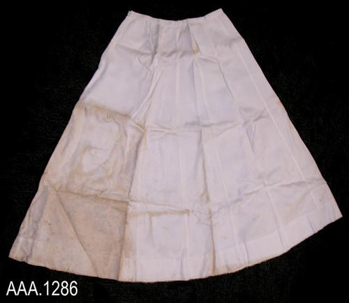 "This artifact is a white skirt.  It measures 45 3/4"" in length and measures 36 1/2"" diameter at the waist.  CONDITION:  There is extensive brown staining on this garmet."