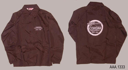 "This artifact is a dark brownish-green jacket.  White lettering on the front of the jacket reads:   ""Corona Centennial - 1886-1986.""  On the back is a circular logo, printed in white, which reads:  ""Corona - Centennial; - 1886 -1986 - To Cherish Our Past - To Plan Our Future.""  This jacket is an adult size ""S"".  QUANTITY:  2"