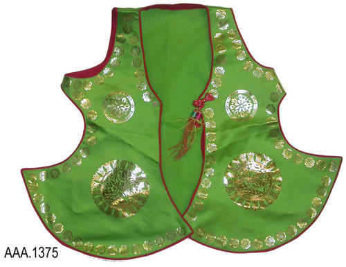 This artifact is vest belonging to a Korean costume.  The material is green with red piping on the edges.  There is a small metallic gold flower design at the edge with a larger geometric circular design on the body of the costume.