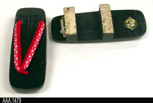 "This artifact is a pair of Japanese, Wooden Sandals called a Geta.  A cloth thong holds the Geta on the foot.  MEASUREMENTS:  Length:  9 3/8"", Width 3"".  The wooden riser (shoe height called a Ha) is 1 5/8"" - CONDITION:  Very good. - INFORMATIONAL NOTE:  Gotsu, Japan is Corona's Sister City.  Online information about Gotsu may be seen at:  http://www.city.gotsu.lg.jp/186.html"