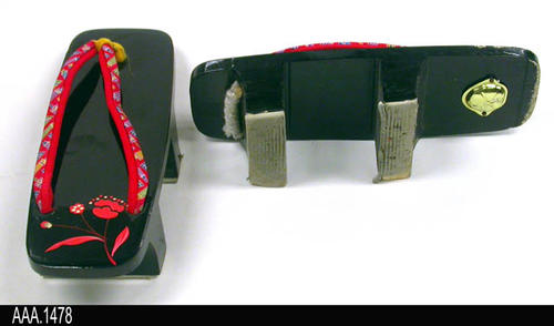 "This artifact is a pair of Japanese, Wooden Sandals called a Geta.  A cloth thong holds the Geta on the foot.  MEASUREMENTS:  Length:  9"", Width 3 1/4"".  The wooden riser (shoe height called a Ha) is 1 3/4"" - CONDITION:  Very good. - INFORMATIONAL NOTE:  Gotsu, Japan is Corona's Sister City.  Online information about Gotsu may be seen at:  http://www.city.gotsu.lg.jp/186.html"