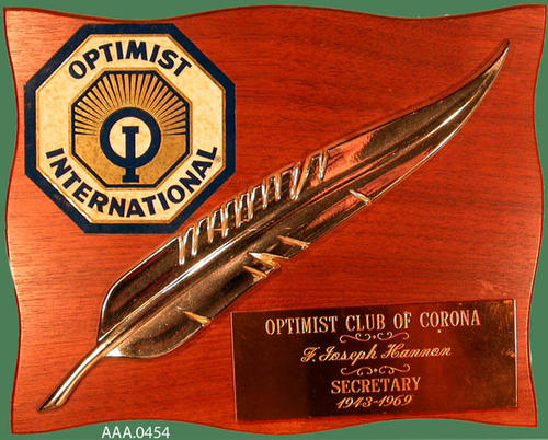 "This artifact is a wood plaque that is inscribed as follows:  ""Optimist Club of Corona - F. Joseph Hannon - Secretary - 1943-1969"""