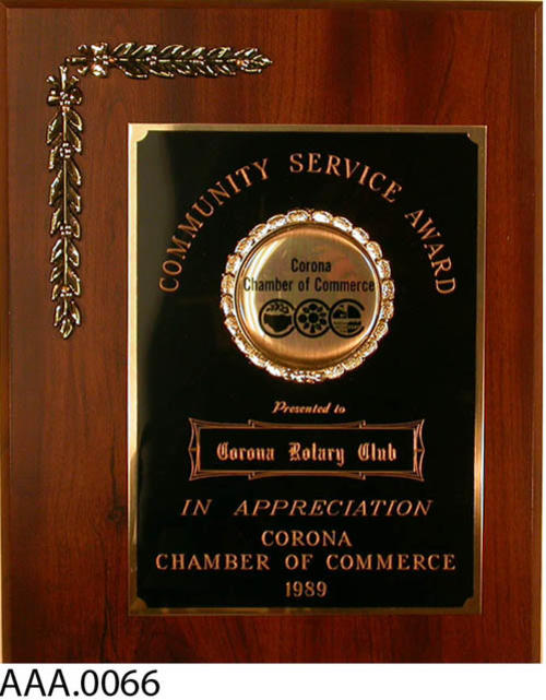 This artifact is a Community Service Award presented to the Corona Rotary Club by the Corona Chamber of Commerce in 1989.