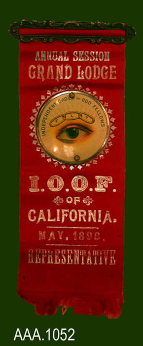 "This artifact is a badge from the Independent Order of Odd Fellows (IOOF).  The text on the front of the badge reads:  ""ANNUAL SESSION - GRAND LODGE - (then an IOOF logo) - I.O.O.F. - OF - CALIFORNIA - MAY, 1899. - REPRESENTATIVE."" This badge belonged to Major Kirby."