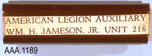 "This artifact is a wood block, rubber stamp.  The text printed by the stamp reads:  ""American Legion Auxiliary - Wm. H. Hameson, Jr. Unit 216 - Corona, California."" This stamp measures 2 1/2"" x 1 1/2""."