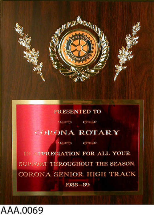 "This artifact is a plaque which is inscribed as follows:  ""Rotary International presented to Corona Rotary in appreciation for all your support throughout the season.  Corona Sr. High Track 1988-1989."""