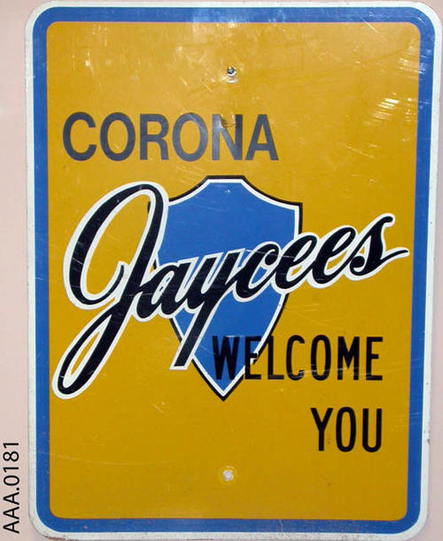 "This artifact is a metal sign.  It displays the following text:  ""Corona Jaycees Welcome You."""