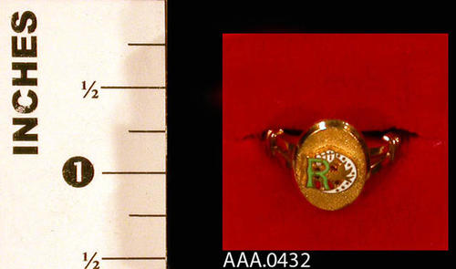 This artifact is a gold ring from the Odd Fellows Lodge and Rebekah Assembly.  It has the Rebekah logo on the face. Donor's Remarks:  This is Alys Tuthill's ring which she wore as a member of the Rebekah lodge.